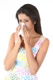 young woman sneezing Stock Photo