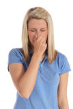 Young woman sneezing Stock Photos