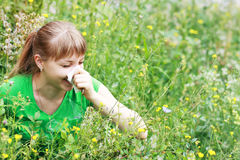 Young woman sneezing Royalty Free Stock Photos