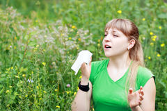 Young woman sneezing Stock Image