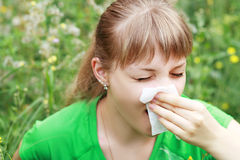 Young woman sneezing Royalty Free Stock Images