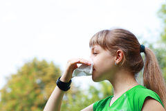 Young woman sneezing Stock Photography