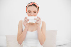 Young woman sneezing into a handkerchief Stock Photography