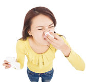 Young woman is sneezing with painful face Stock Photos