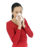 Young woman sneezing to a paper handkerchief Stock Photos