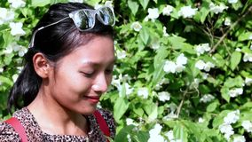 Young woman sniff the flowers stock footage