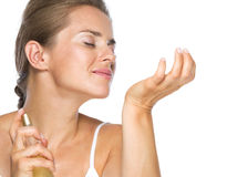 Young woman sniffing hand Stock Image