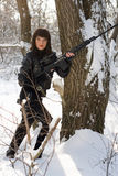 Young woman with a sniper rifle. Near the tree Stock Photo