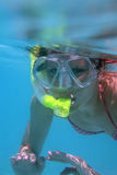 Young woman snorkeling. Royalty Free Stock Photo