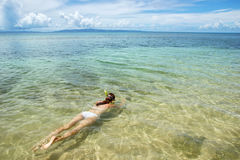 Young woman snorkeling in clear water on Taveuni Island, Fiji Royalty Free Stock Photos