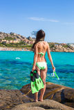 Young woman with snorkeling equipment ready for Royalty Free Stock Images
