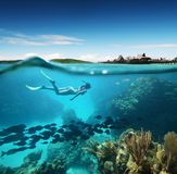 Young Woman Snorkeling In The Coral Reef In The Tropical Sea
