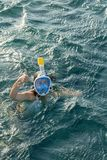 Young woman snorkeling in transparent shallow. Young woman at snorkeling in the tropical water. active woman free diving. Snorkeling in beautiful blue ocean on stock photos