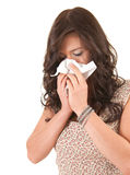 Young woman with snotty, runny nose and tissue Royalty Free Stock Photos