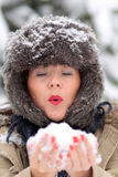 Young woman with snow. Young woman blowing the snow kept in her hands Royalty Free Stock Photos
