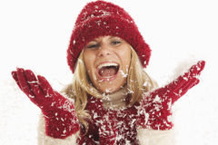 Young woman in the snow Stock Photo