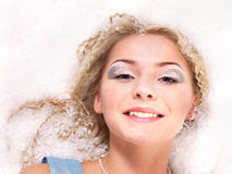 Young woman with snow. Royalty Free Stock Photo