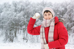Young woman with snow ball Royalty Free Stock Photos