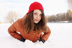 Young woman in the snow Royalty Free Stock Photos