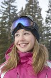 Young Woman In Snow Coat And Ski Glasses Stock Photography