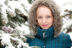 Young woman in snow-covered spruce forest Royalty Free Stock Photo