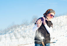 Young woman in a snow fight Royalty Free Stock Images