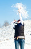 Young woman in a snow fight Stock Image
