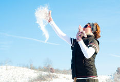 Young woman in a snow fight Stock Images