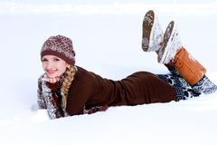 Young woman on the snow outdoors Stock Photos