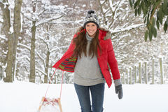 Young woman in snow with sledge Stock Photo