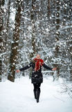 Young Woman in snow winter forest happy. Pretty young Woman in snow winter forest happy royalty free stock image