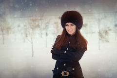 Young Woman in The Snow in Wintertime Royalty Free Stock Photo