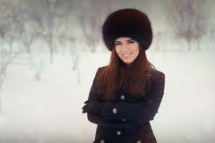 Young Woman in The Snow in Wintertime Royalty Free Stock Image