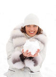 Young woman with a snowball Stock Photography