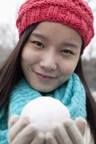 Young Woman with Snowball Stock Images
