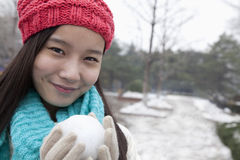Young Woman with Snowball, Smiling and Looking At Camera Stock Photography