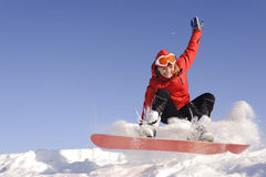 Young woman on snowboard Royalty Free Stock Photography