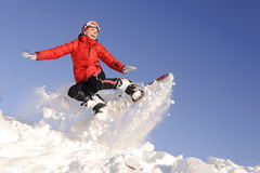 Young woman on snowboard Royalty Free Stock Photo