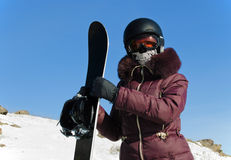The young woman with a snowboard Royalty Free Stock Photos
