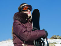 The young woman with a snowboard Royalty Free Stock Images