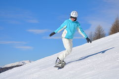 Young woman on snowboard Royalty Free Stock Image