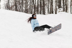 Young woman on snowboard Stock Photos