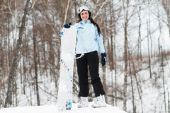 Young woman on snowboard Stock Images