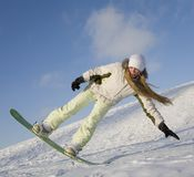 Young woman on snowboard Royalty Free Stock Images