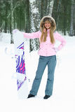 Young woman with a snowboard Stock Images