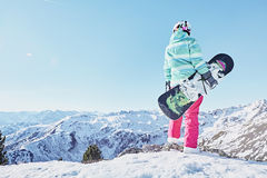 Young woman with snowboard Royalty Free Stock Images