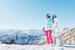 Young woman with snowboard Royalty Free Stock Photo