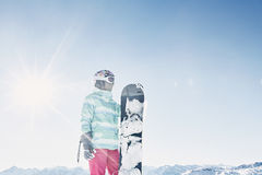 Young woman with snowboard Stock Images