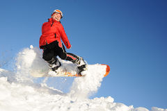 Young woman on the snowboard jumping Stock Image