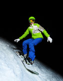 Young woman on snowboard at night Royalty Free Stock Photo
